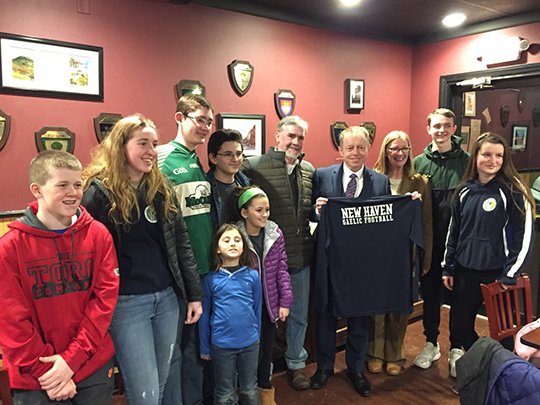 Minister Cannon with New Haven Gaelic football shirt