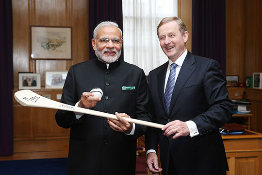 Prime Minister Narendra Modi of India at Government buildings with Taoiseach Enda Kenny being presesnted with a hurl and sliotar. Photo: Maxwells Dublin