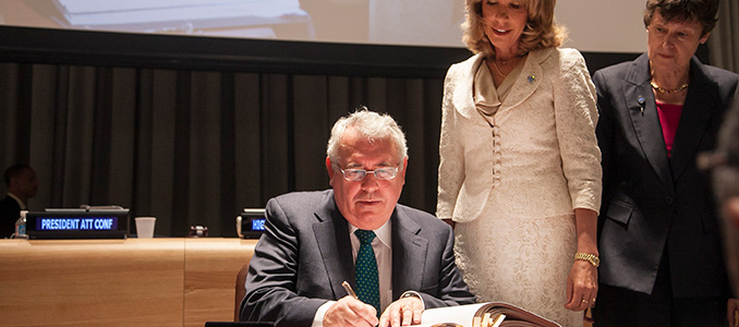 Minister Costello signing the Arms Trade Treaty in the presence of UN Under-Secretary General for Legal Affairs, Patricia O'Brien and High Representative for Disarmament Affairs, Angela Kane