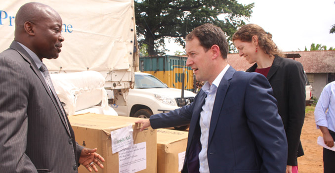 Minister Seán Sherlock with Gon Myers, WFP Country Rep at the Freetown WFP warehouse with Irish Aid stocks