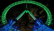 The London Eye at night lit green to celebrate St Patrick's Day