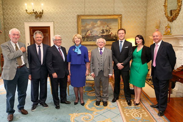 President Higgins and Sabina Higgins welcome participants to Áras an Uachtaráin