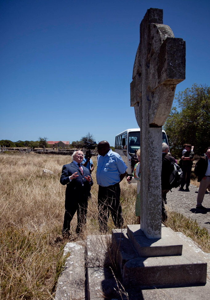 Pictured is President Michael D Higgins with Thulani Mabaso , a political prisioner at Robben Island from 86-91, viewing the Irish Cross erected in the Irish Village to comemorate the Irish who worked in the Leper Colony on Robben Island, Cape Town, on the nineteenth day of the Presidents 22 day official visit to Ethiopia, Malawi and South Africa.Photo Chris Bellew / Fennell Photography 2014