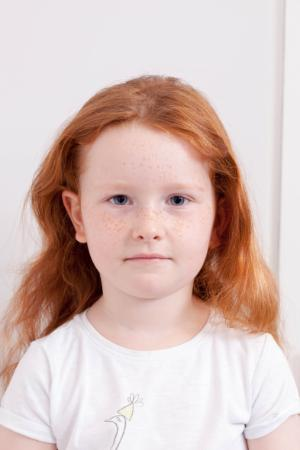 Example of Unacceptable Child Passport Photograph - Background