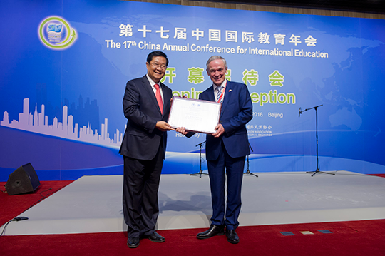 Minister Bruton receiving the Country of Honour Award from CEAIE President Dr. Liu Limin. Credit: Education in Ireland