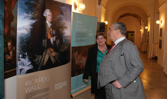 Ambassador Alison Kelly with former Foreign Minister Karel Schwarzenberg viewing the Strangers to Citizens exhibition at St. Patrick's Day Reception 2013, Břevnov Monastery, Prague