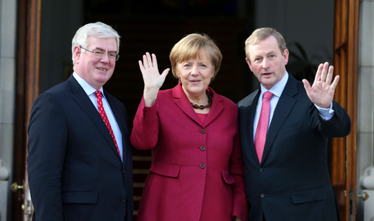 Chancellor Angela Merkel with An Taoiseach Enda Kenny and former Tánaiste Eamon Gilmore.