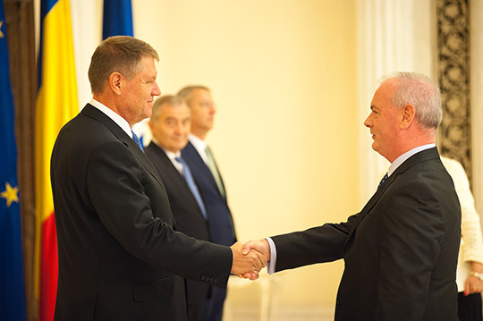 Ambassador Derek Feely shaking hands with President Iohannis, Bucharest. Credit: Presidential Administration