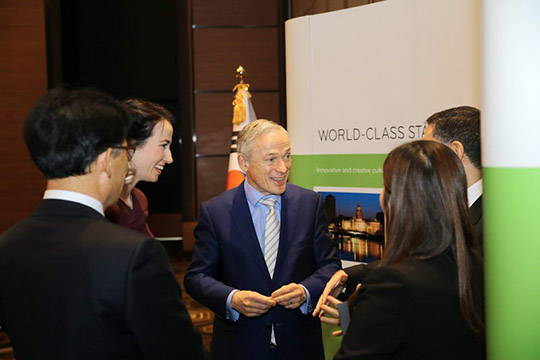 "Minister Bruton chats with guests at the ""Ireland & Korea: Partners in Education"" event"