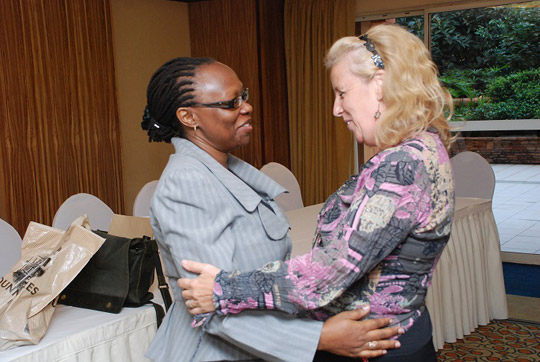 Janet Shimanya welcoming Joan Kelly (an Irish Business lady in Uganda)