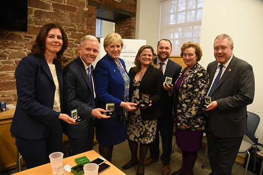 Minister Humphreys, Consul General, Speaker and Irish Caucus members showing their gift - commemoration coin