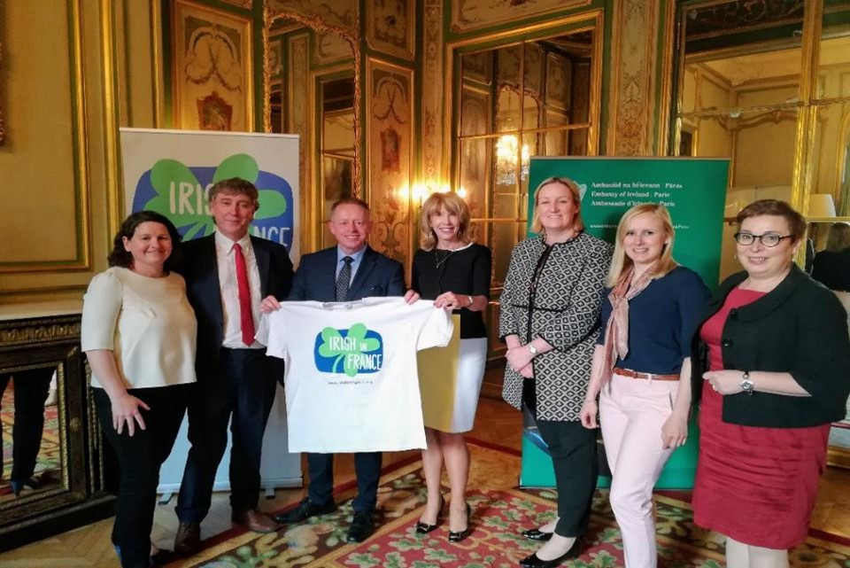 Some members of The Irish in France board, and Honorary President Ambassador Patricia O'Brien present Minister of State Cannon with an Irish in France T Shirt during his visit to Paris.