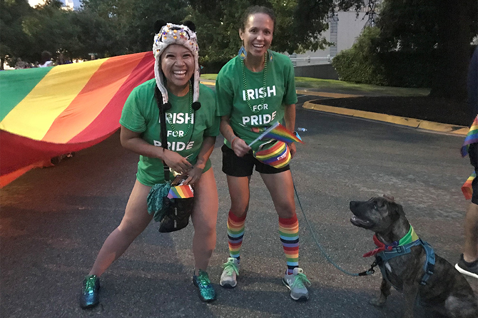 "Members of the Celtic Cowboys GAA Club and ""Storm"" the dog marching with the ""Irish for Pride"" group at Austin Pride 2018."