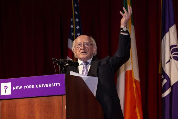 President Higgins speaking at NYU