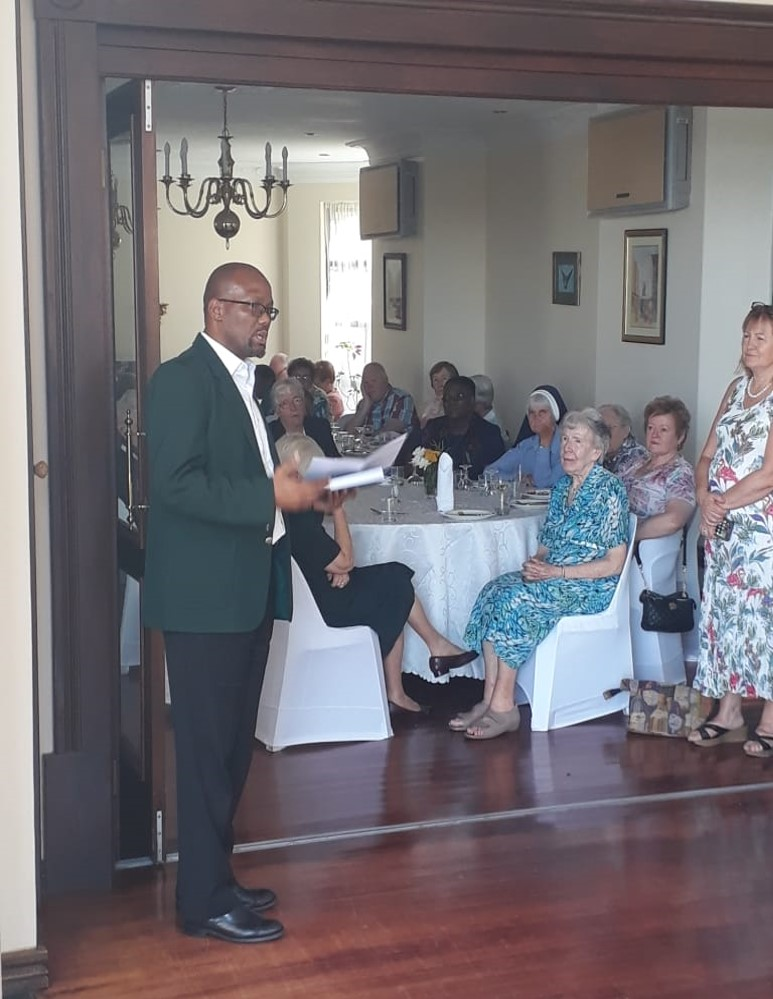 Elias Masilela, who was taught by Irish missionaries, speaking at Irish missionaries' event at residence of Ambassador