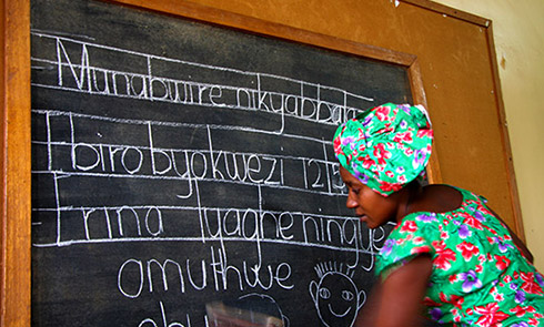 Edith teaching children in their local language