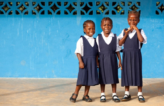 Schoolgirls from Grand Bassa, Liberia share a smile. Photo: Concern Worldwide